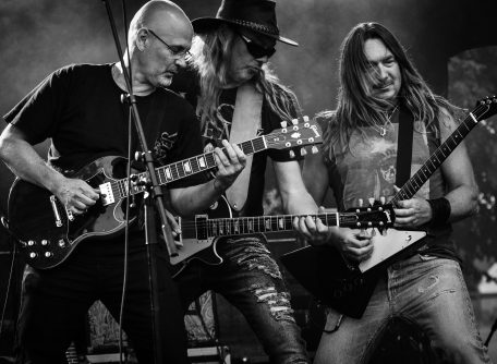 Canva - Group of Men Playing Guitar in Concert in Grayscale Photo